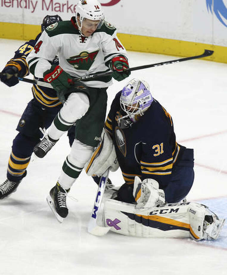 Minnesota Wild center Joel Eriksson Ek (14) screens Buffalo Sabres goalie Anders Nilsson (31) during the second period of an NHL hockey game, Thursday, Oct. 27, 2016, in Buffalo, N.Y. (AP Photo/Jeffrey T. Barnes)