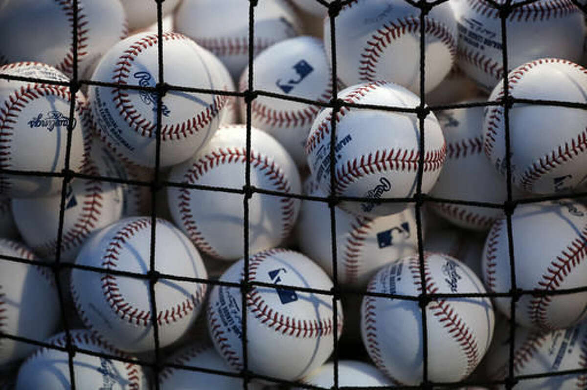 A pile of batting practice balls are seen as Cleveland Indians players work out during batting practice for Friday's Game 3 of the Major League Baseball World Series against the Chicago Cubs, Thursday, Oct. 27, 2016, in Chicago. (AP Photo/Charles Rex Arbogast)