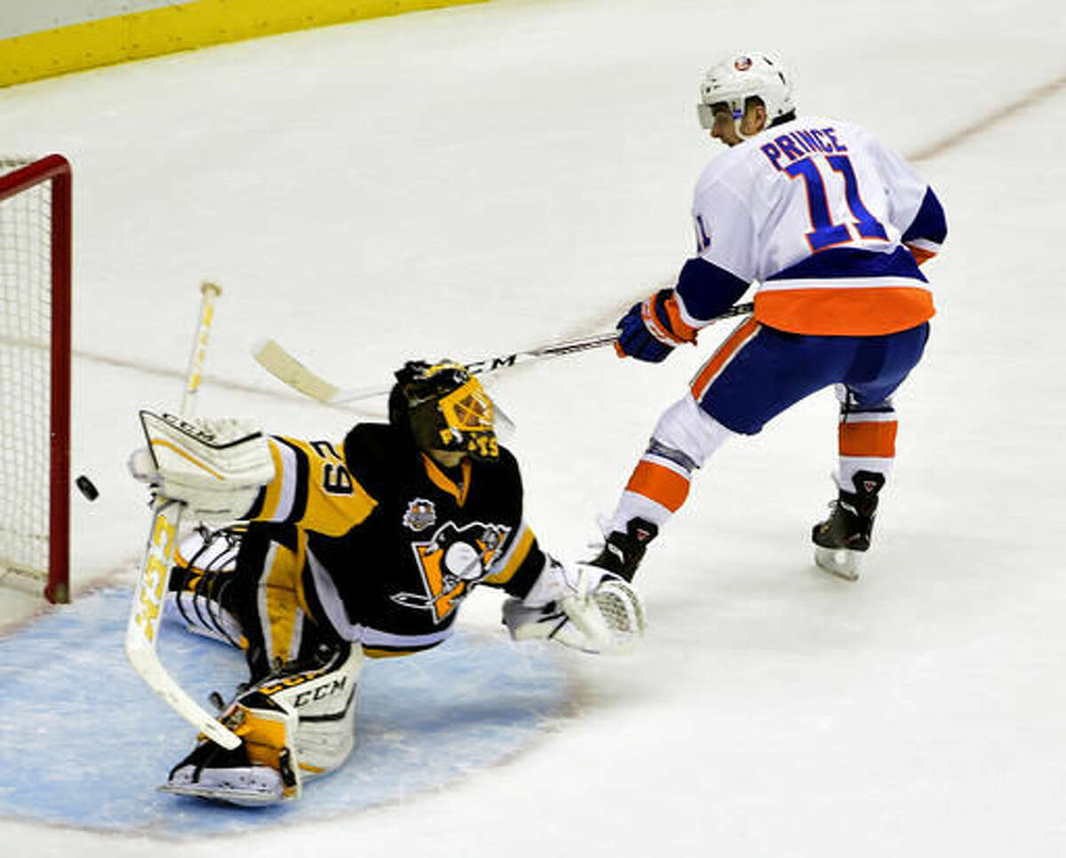 Pittsburgh Penguins goalie Marc-Andre Fleury (29) makes a save against New York Islanders center Shane Prince (11) during the first period of an NHL hockey game on Thursday, Oct. 27, 2016, in Pittsburgh. (AP Photo/Fred Vuich)