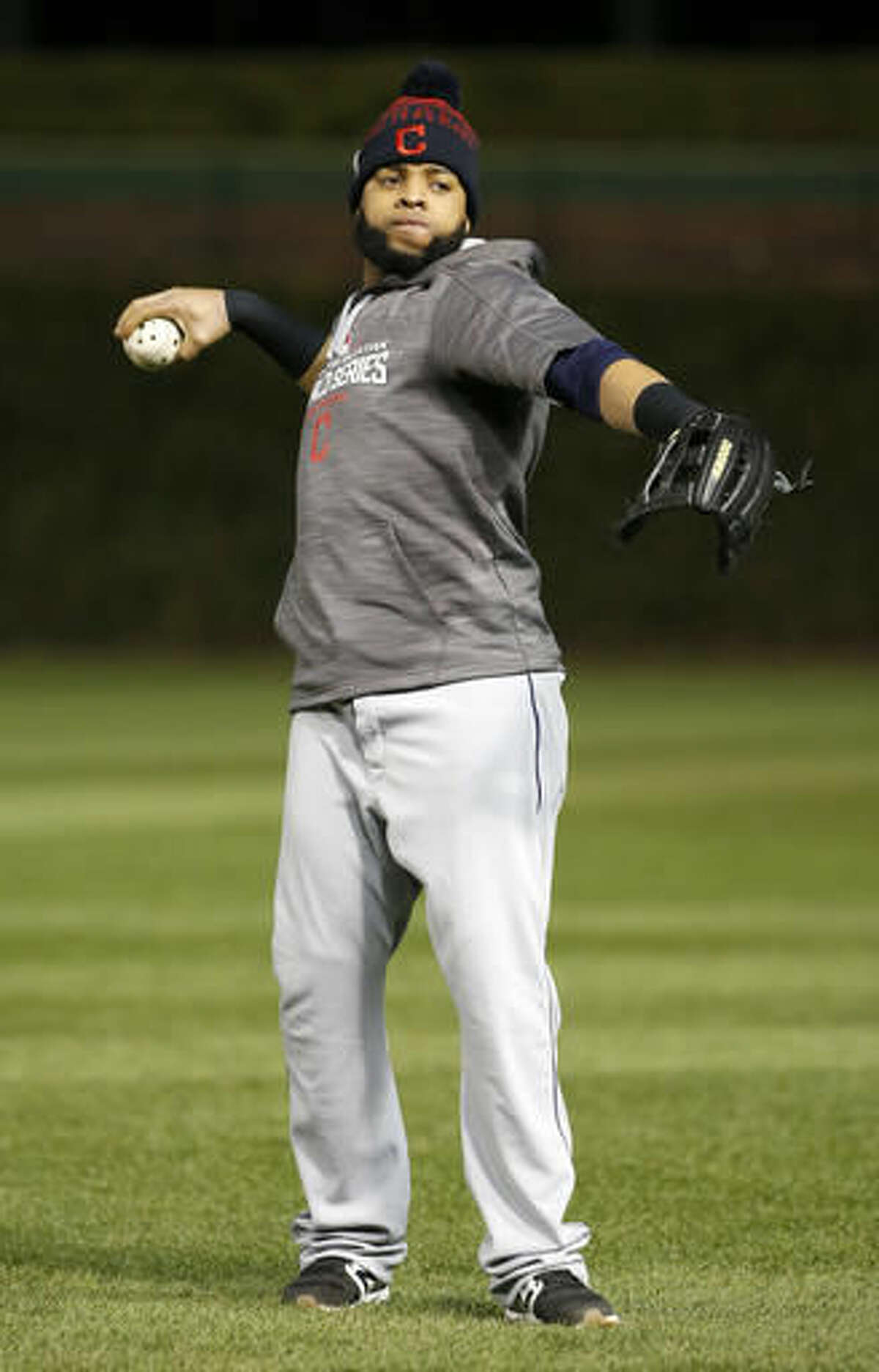 Cleveland Indians' Carlos Santana works out during batting practice for Friday's Game 3 of the Major League Baseball World Series against the Chicago Cubs, Thursday, Oct. 27, 2016, in Chicago. (AP Photo/Nam Y. Huh)