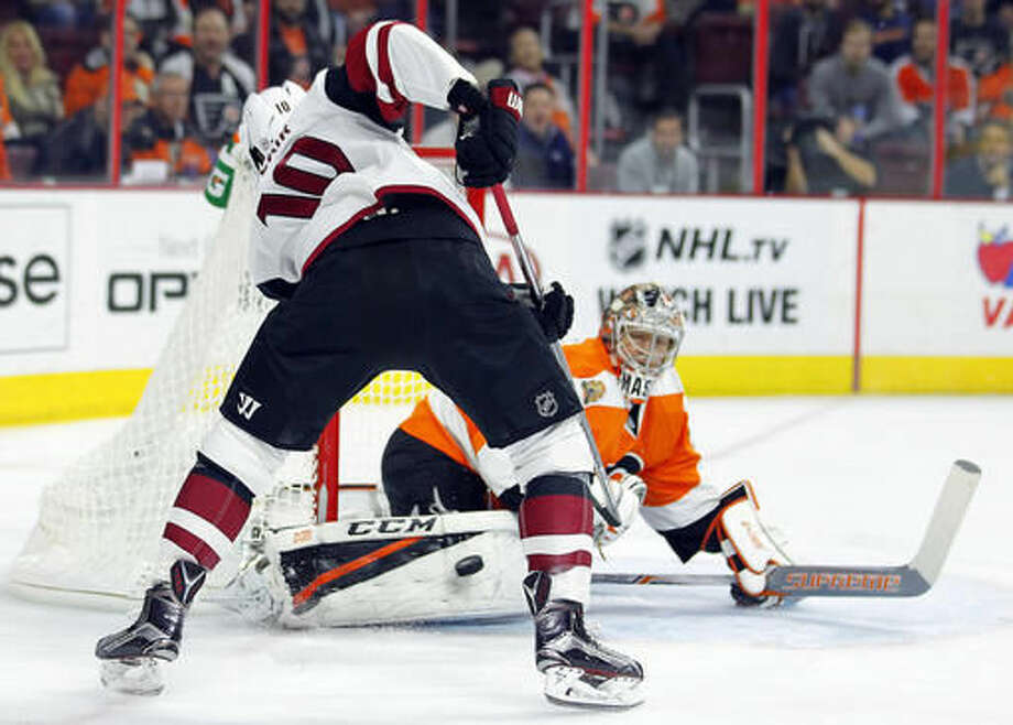 Philadelphia Flyers' Steve Mason, right, save a shot by Arizona Coyotes' Anthony Duclair during the first period of an NHL hockey game, Thursday, Oct. 27, 2016, in Philadelphia. (AP Photo/Tom Mihalek)