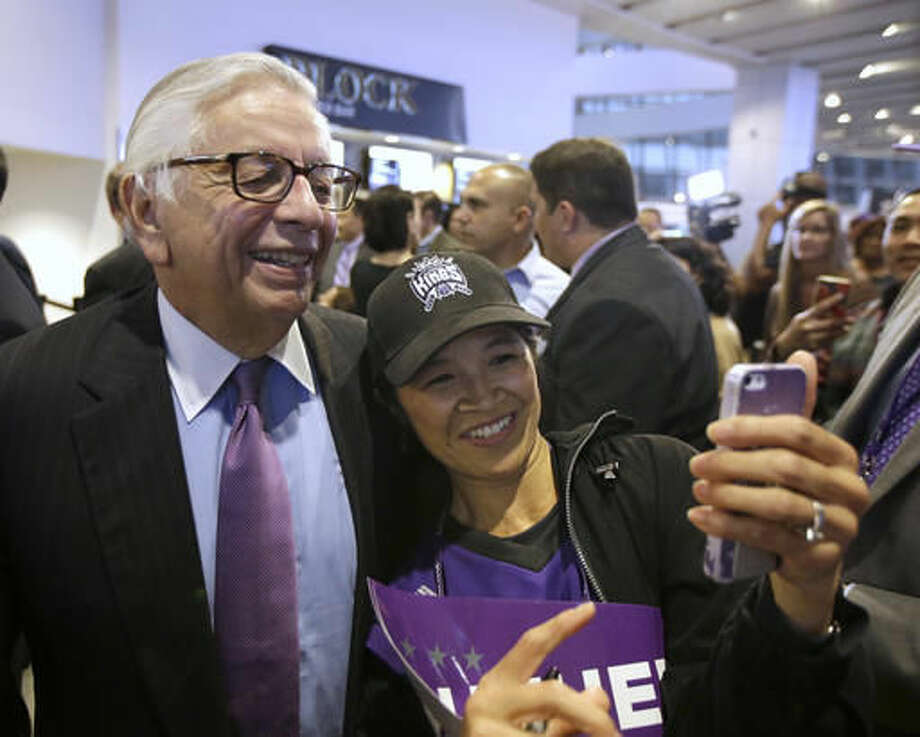 Former NBA Commissioner David Stern poses for a selfie with Sacramento Kings fan Maelin Perez, as he toured the new Golden One Center in Sacramento, Calif., Thursday, Oct. 27, 2016. The Kings are playing the San Antonio Spurs in the first regular NBA basketball game at the new arena. (AP Photo/Rich Pedroncelli)