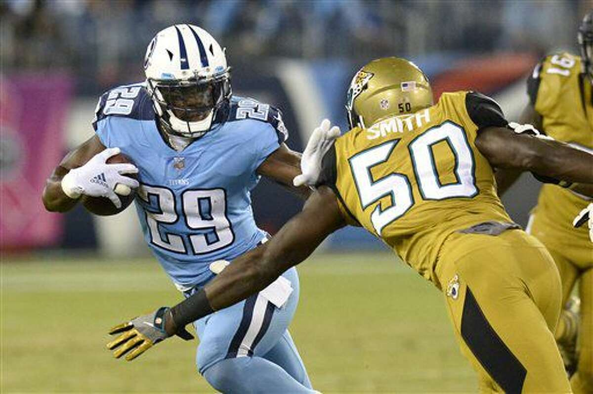Tennessee Titans running back DeMarco Murray (29) tries to get past Jacksonville Jaguars linebacker Telvin Smith (50) in the first half of an NFL football game Thursday, Oct. 27, 2016, in Nashville, Tenn. (AP Photo/Mark Zaleski)