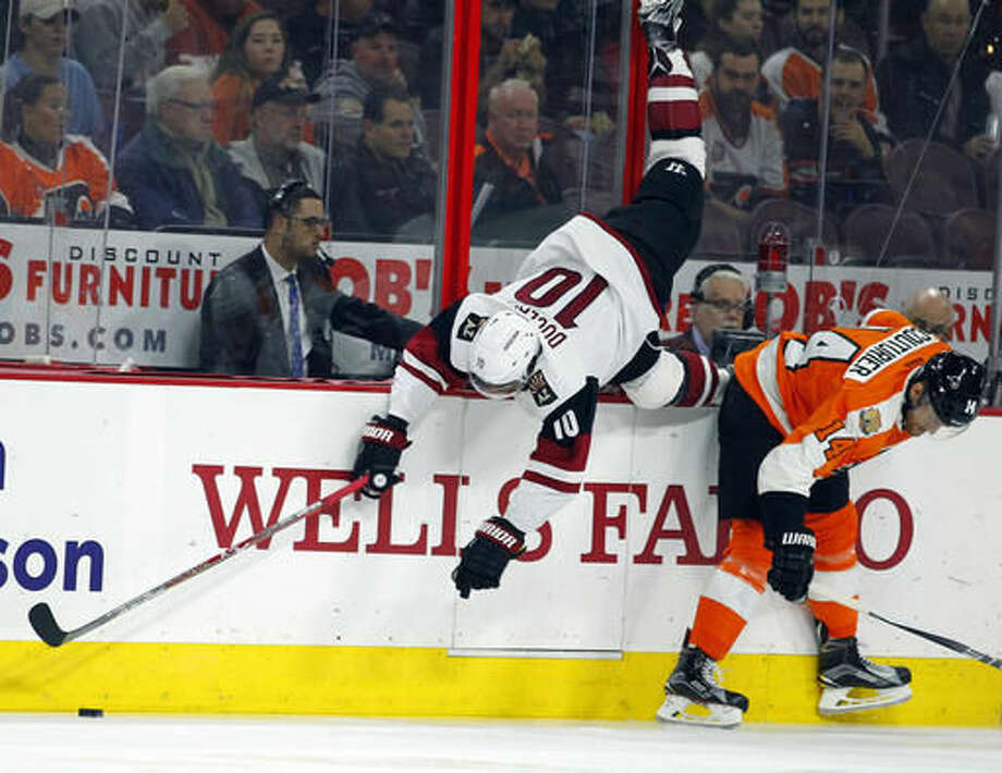 Arizona Coyotes' Anthony Duclair, left, cartwheels over Philadelphia Flyers' Sean Couturier during the first period of an NHL hockey game, Thursday, Oct. 27, 2016, in Philadelphia. (AP Photo/Tom Mihalek)