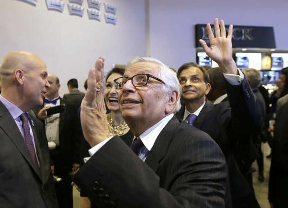Former NBA Commissioner David Stern, center, and Sacramento Kings majority owner Vivek Ranadive, right, wave to fans as they tour the Golden One Center, the new home of the Sacramento Kings in Sacramento, Calif., Thursday, Oct. 27, 2016. The Kings are playing the San Antonio Spurs in the first regular NBA basketball game the new arena. (AP Photo/Rich Pedroncelli)