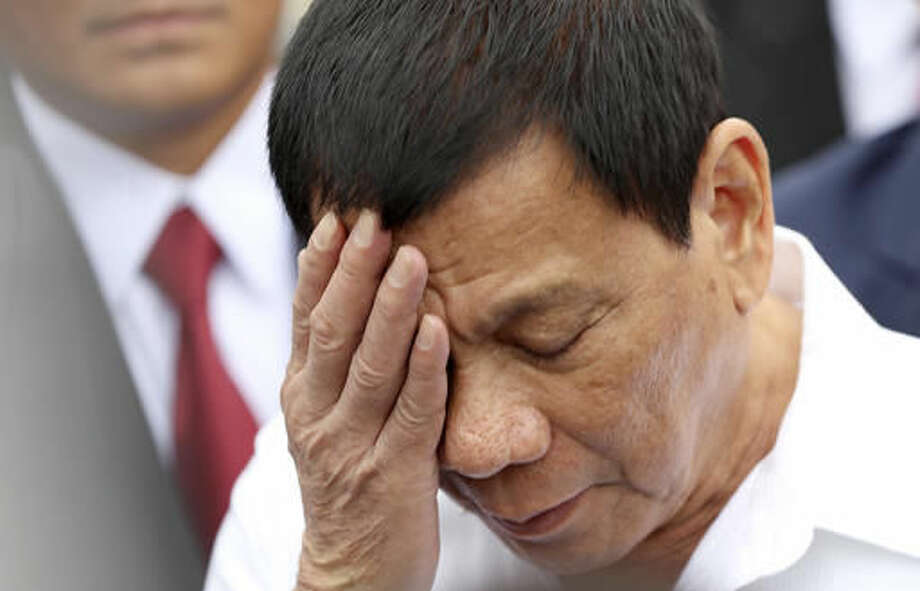 Philippine President Rodrigo Duterte speaks to journalists after inspecting a coast guard training demonstration at a Japan Coast Guard base in Yokohama, Thursday, Oct. 27, 2016. Duterte is on a three-day official visit to Japan, his first as Philippine leader. (AP Photo/Eugene Hoshiko)