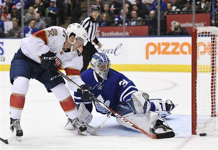 Florida Panthers center Greg McKegg (41) is stopped by Toronto Maple Leafs goalie Frederik Andersen (31) during the first period of an NHL hockey game in Toronto on Thursday, Oct. 27, 2016. (Frank Gunn/The Canadian Press via AP)