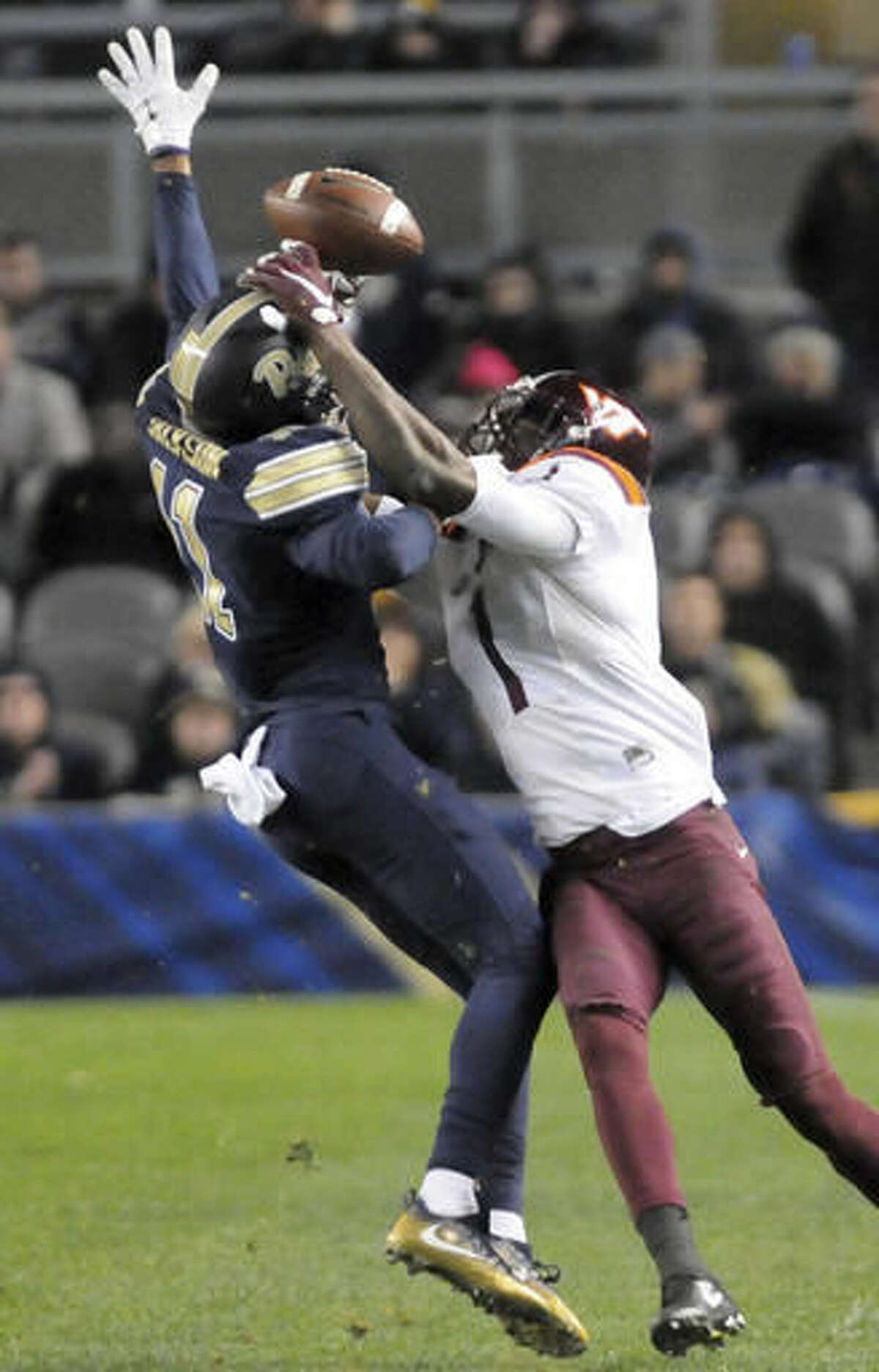 Pittsburgh defensive back Dane Jackson, left, cannot stop a completed pass to Isiah Ford, right, in the second half of an NCAA college football game, Thursday, Oct. 27, 2016, in Pittsburgh. (AP Photo/John Heller)