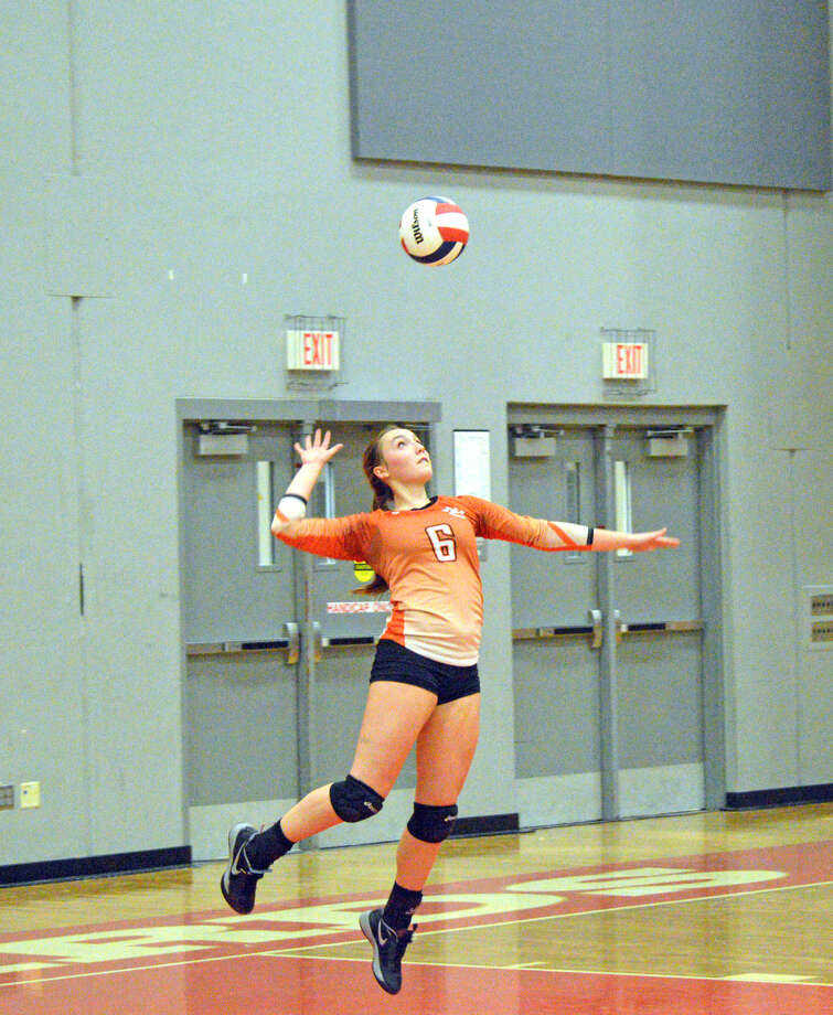 Edwardsville junior Rachel Verdun goes up for a serve in the second game.