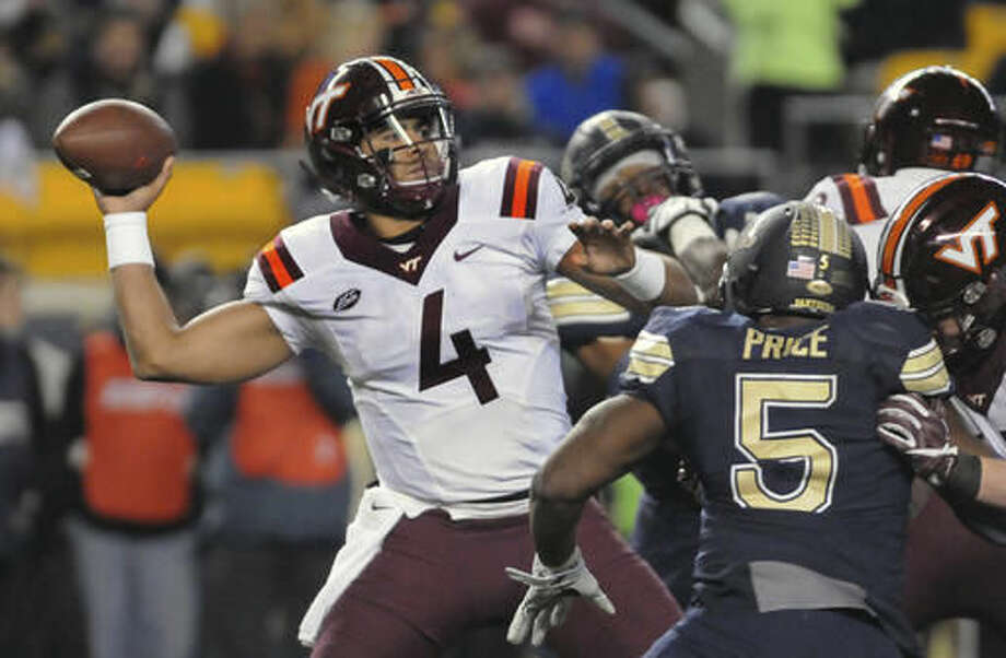 Virginia Tech quarterback Jerod Evans (4) throws the ball against Pittsburgh in the first half of an NCAA college football game Thursday, Oct. 27, 2016, in Pittsburgh. (AP Photo/John Heller)