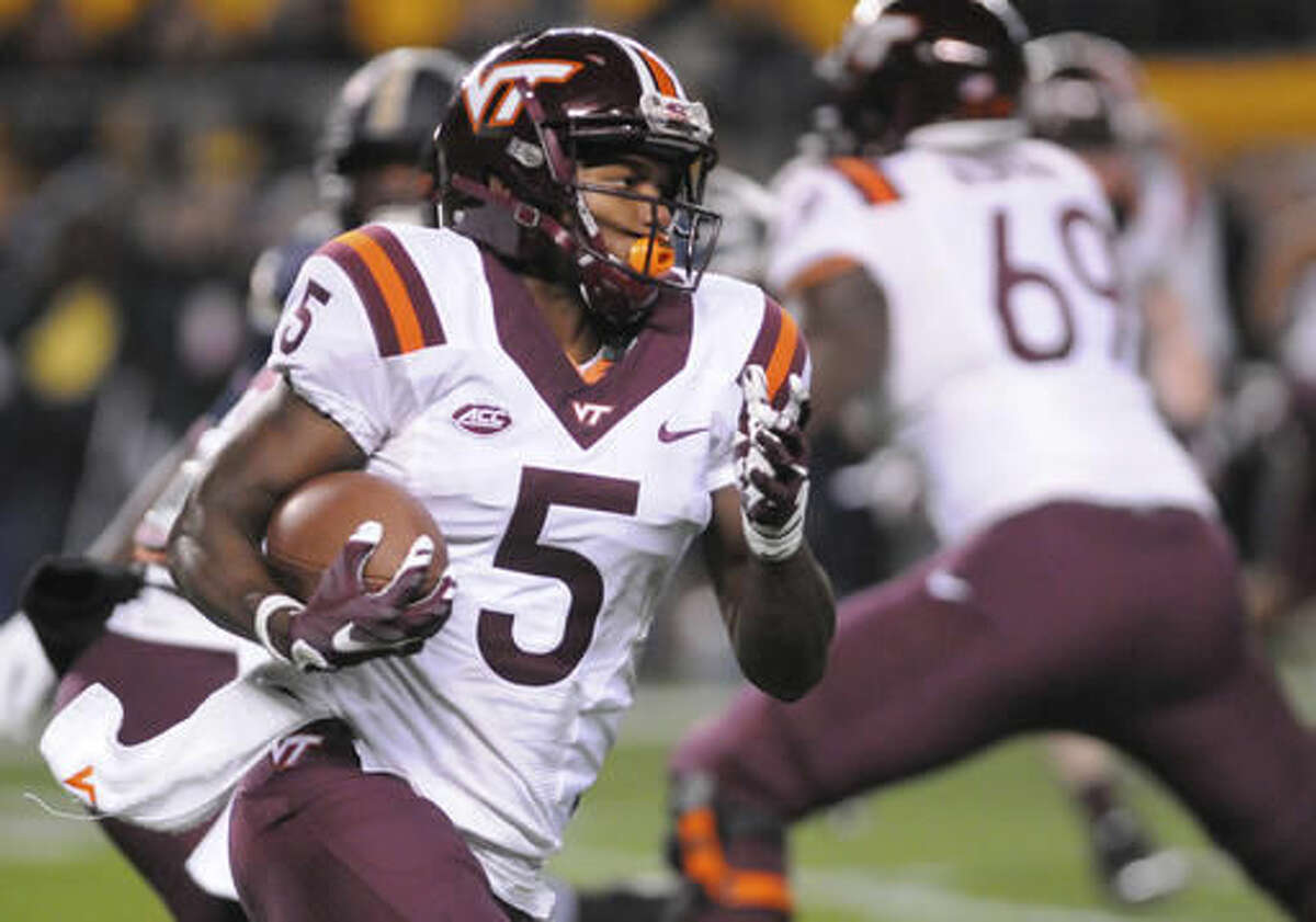 Virginia Tech wide receiver Cam Phillips (5) picks up yardage against Pittsburgh during an NCAA college football game Thursday, Oct. 27, 2016, in Pittsburgh. (AP Photo/John Heller)