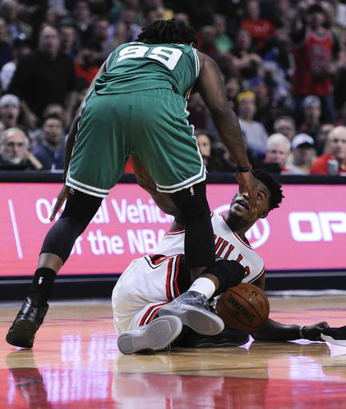 Chicago Bulls' Jimmy Butler and Boston Celtics' Jae Crowder (99) react as the teams argue during the second quarter of an NBA basketball game Thursday, Oct. 27, 2016, in Chicago. (AP Photo/Matt Marton)