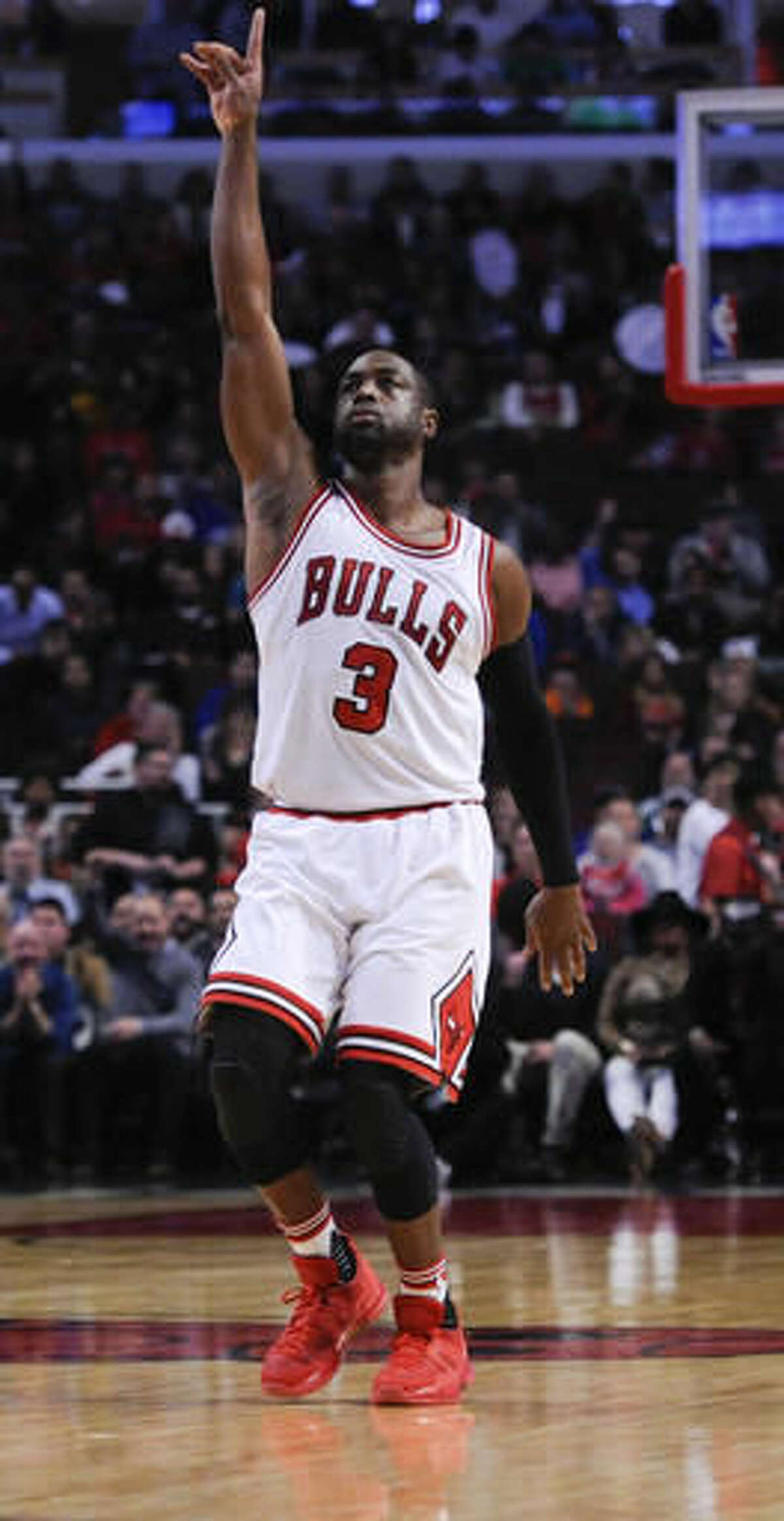 Chicago Bulls guard Dwyane Wade gestures after scoring his first basket during the first quarter of an NBA basketball game against the Boston Celtics, Thursday, Oct. 27, 2016, in Chicago. (AP Photo/Matt Marton)