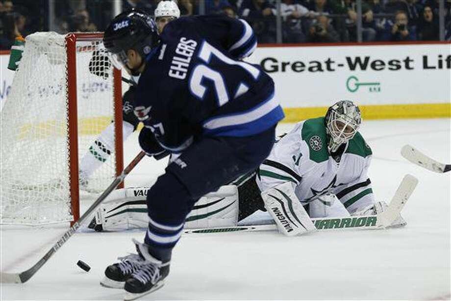 Winnipeg Jets' Nikolaj Ehlers (27) misses the open net shot against Dallas Stars goaltender Antti Niemi (31) during the second period of an NHL hockey game in Winnipeg, Manitoba, Thursday, Oct. 27, 2016. (John Woods/The Canadian Press via AP)