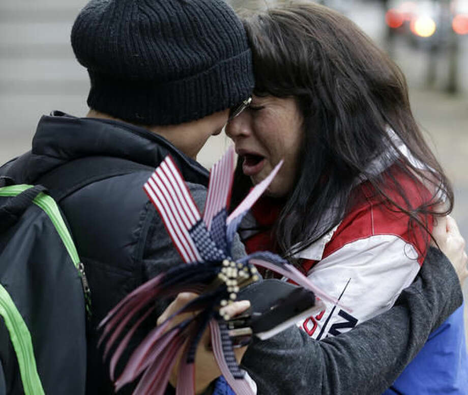 Maureen Valdez, right, cries and hugs another supporter after hearing a verdict outside federal court in Portland, Ore., Thursday, Oct. 27, 2016. A jury exonerated brothers Ammon and Ryan Bundy and five others of conspiring to impede federal workers from their jobs at the Malheur National Wildlife Refuge. (AP Photo/Don Ryan)