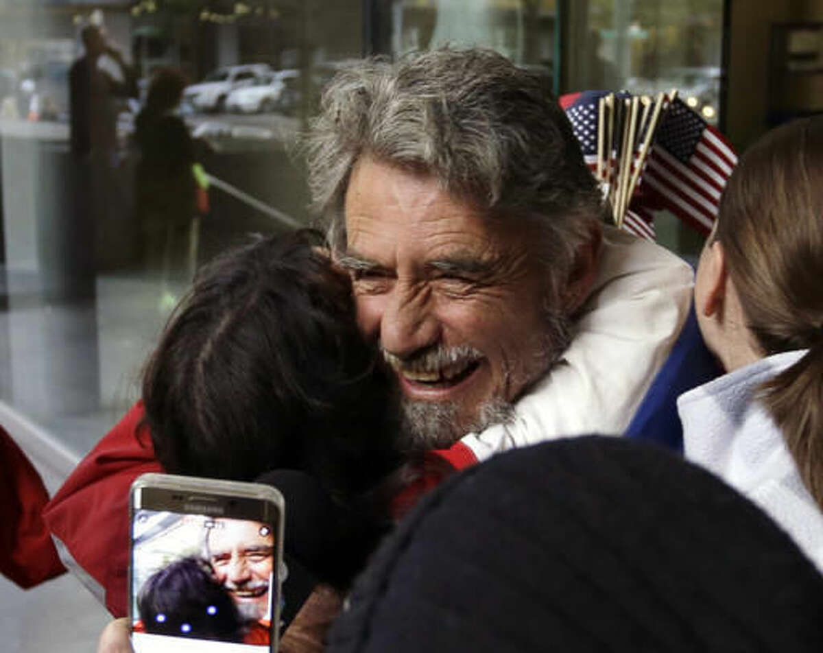 Defendant Neil Wampler is greeted by supporters as he leaves federal court in Portland, Ore., Thursday, Oct. 27, 2016. A jury exonerated brothers Ammon and Ryan Bundy and five others of conspiring to impede federal workers from their jobs at the Malheur National Wildlife Refuge. (AP Photo/Don Ryan)