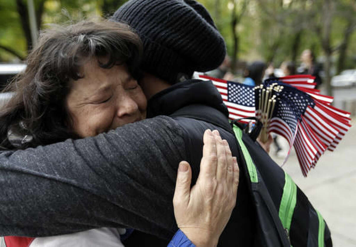 Maureen Valdez, left, hugs another supporter after hearing a verdict outside federal court in Portland, Ore., Thursday, Oct. 27, 2016. A jury exonerated brothers Ammon and Ryan Bundy and five others of conspiring to impede federal workers from their jobs at the Malheur National Wildlife Refuge. (AP Photo/Don Ryan)
