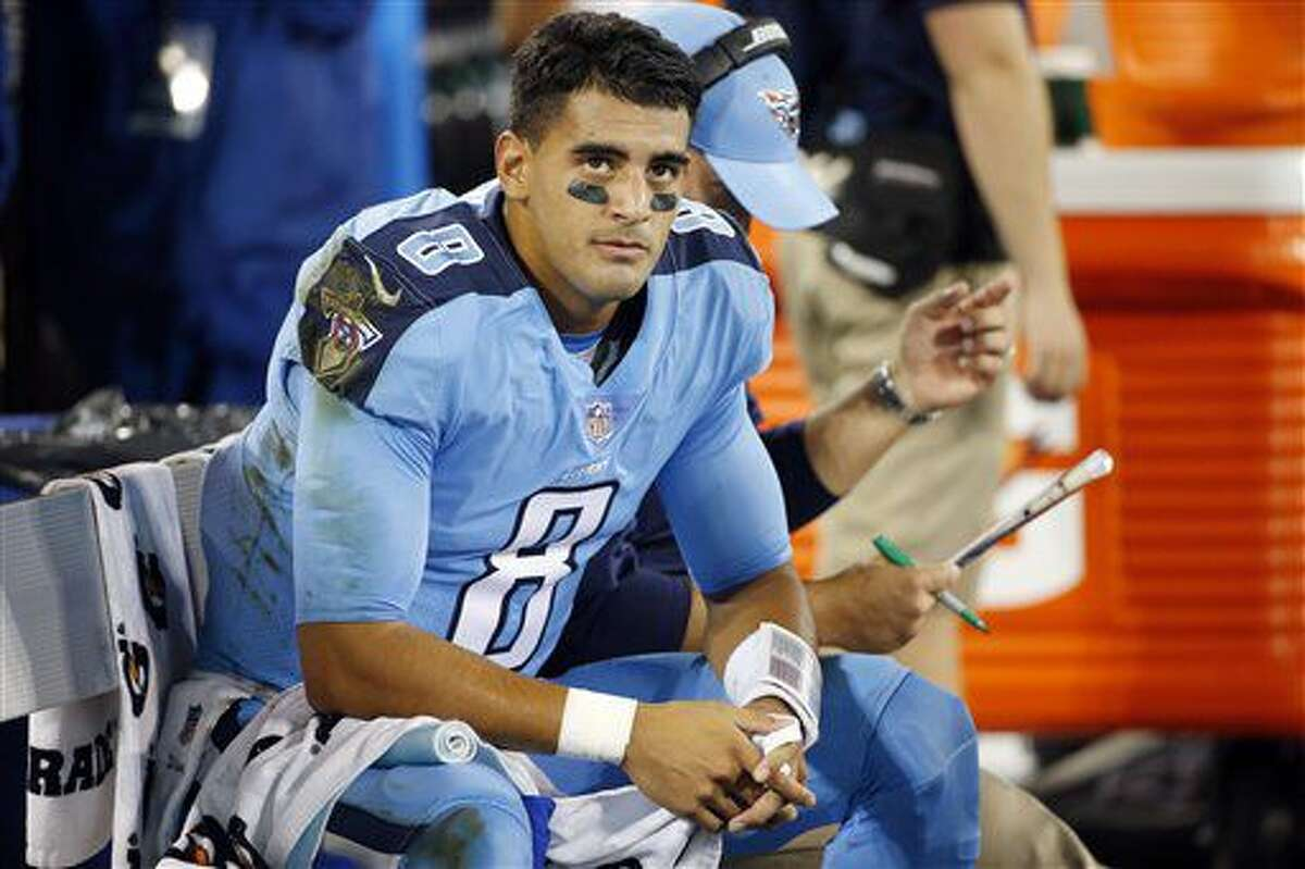 Tennessee Titans quarterback Marcus Mariota watches from the sideline in the first half of an NFL football game against the Jacksonville Jaguars Thursday, Oct. 27, 2016, in Nashville, Tenn. (AP Photo/Weston Kenney)