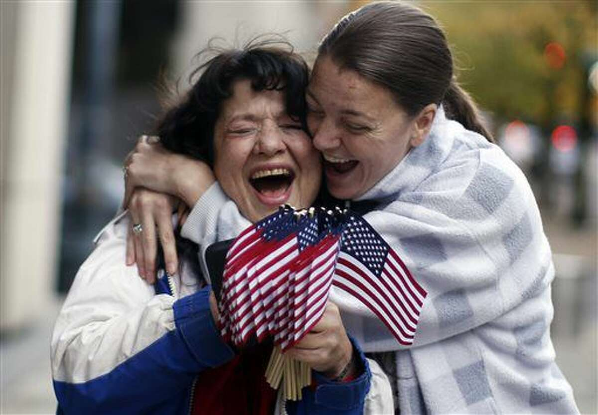 Kelli Stewart, right, celebrates with Maureen Valdez outside the Mark O. Hatfield United States Courthouse after the leaders of an armed group who seized a national wildlife refuge in rural Oregon were acquitted Thursday, Oct. 27, 2016 in the 41-day standoff that brought new attention to a long-running dispute over control of federal lands in the U.S. West. (Beth Nakamura/The Oregonian via AP)