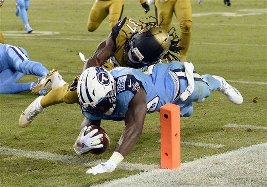 Tennessee Titans running back DeMarco Murray (29) beats Jacksonville Jaguars safety Johnathan Cyprien (37) to the end zone as Murray scores a touchdown on a 14-yard run in the first half of an NFL football game Thursday, Oct. 27, 2016, in Nashville, Tenn. (AP Photo/Mark Zaleski)