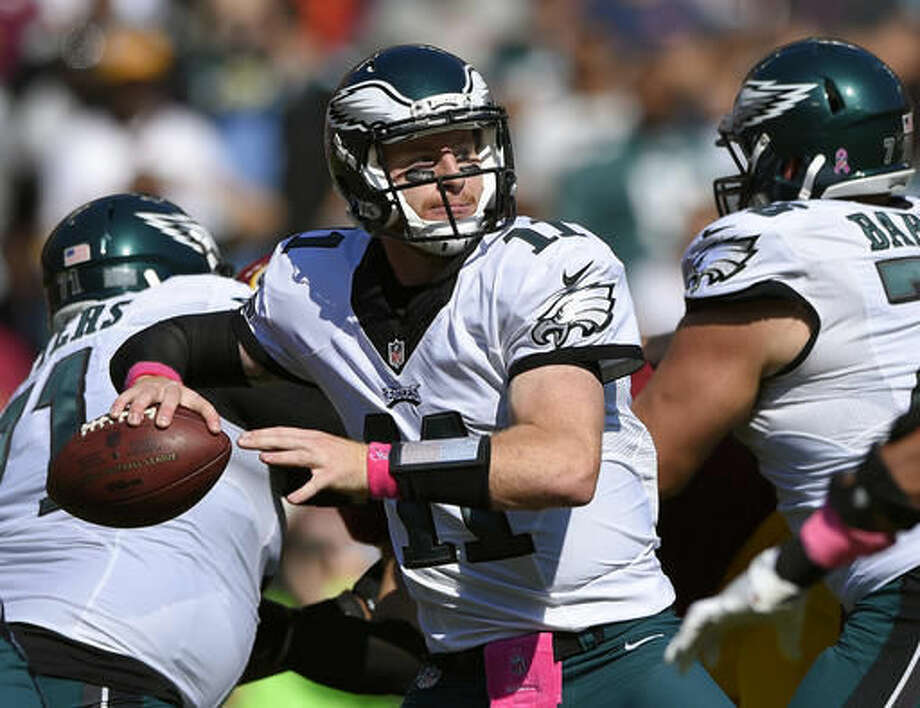 FILE - In this Sunday, Oct. 16, 2016, file photo, Philadelphia Eagles quarterback Carson Wentz throws to a receiver in the first half of an NFL football game against the Washington Redskins in Landover, Md. Wentz leads NFL rookies with eight passing TDs. (AP Photo/Nick Wass, File)