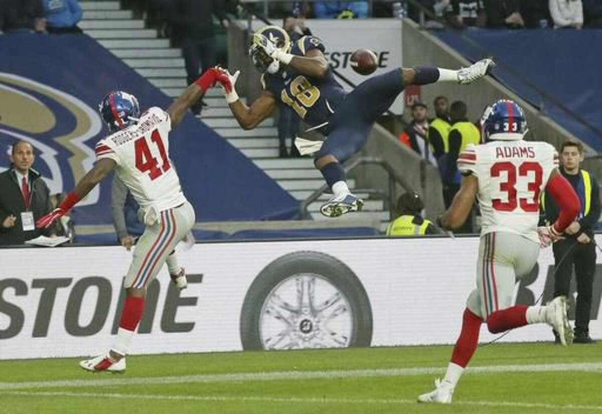 FILE - In this Oct. 23, 2016, file photo, Los Angeles Rams wide receiver Kenny Britt (18) drops the ball as New York Giants cornerback Dominique Rodgers-Cromartie (41) defends during an NFL football game at Twickenham stadium in London. It's a far cry from a year ago when the defense was on the field six times either late in the fourth quarter or in overtime and gave up a winning score as the Giants missed the playoffs for a fourth straight season.(AP Photo/Tim Ireland, File)