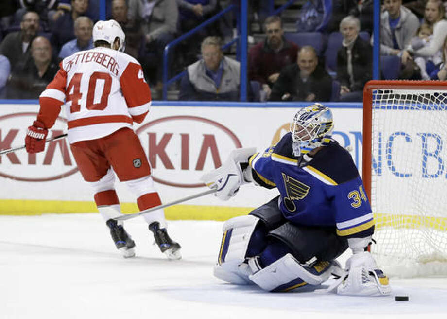St. Louis Blues goalie Jake Allen, right, is slow to get up after giving up the winning goal to Detroit Red Wings' Henrik Zetterberg, of Sweden, during a shootout of an NHL hockey game Thursday, Oct. 27, 2016, in St. Louis. (AP Photo/Jeff Roberson)