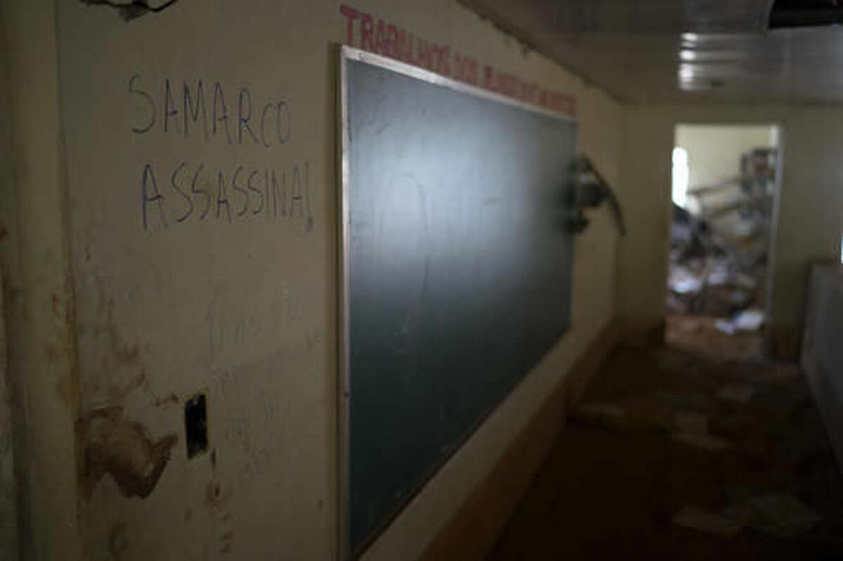 This Oct. 13, 2016 photo shows a scrawled message in Portuguese that reads;
