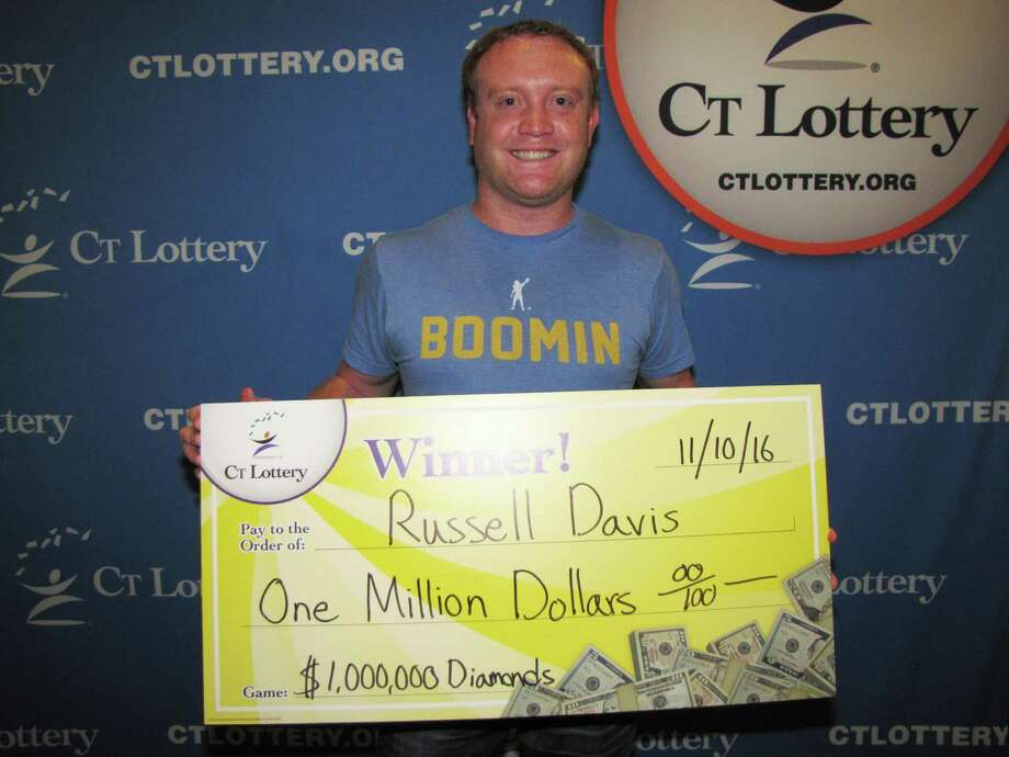 Russell Davis, of Milford, Milford man was a big winner in a CT Lottery games in November. Davis claimed a $1 million prize at CT Lottery headquarters in Rocky Hill. $1,000,000 Diamonds top prizes are paid as a 20-year annuity or a one-time lump sum equivalent. Davis opted to select the lump sum option valued at $720,000. Photo: CT Lottery Photo