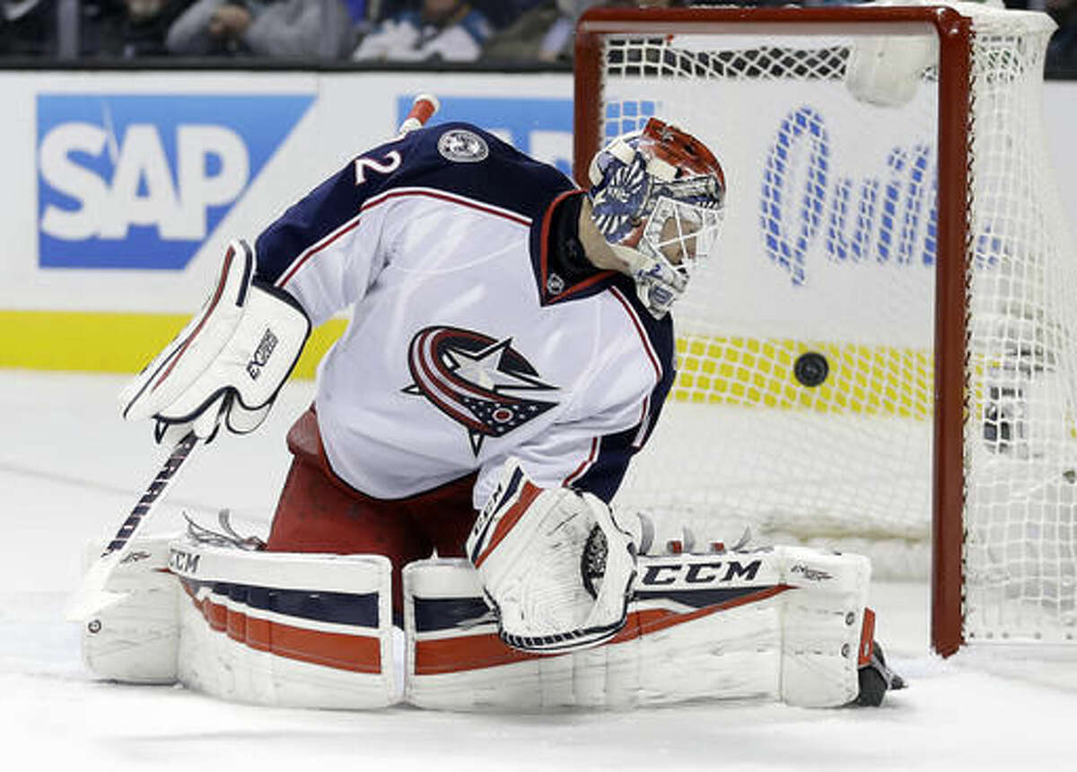 Columbus Blue Jackets goalie Sergei Bobrovsky watches as a puck hit by San Jose Sharks' Joonas Donskoi gets past him for a goal during the first period of an NHL hockey game Thursday, Oct. 27, 2016, in San Jose, Calif. (AP Photo/Ben Margot)