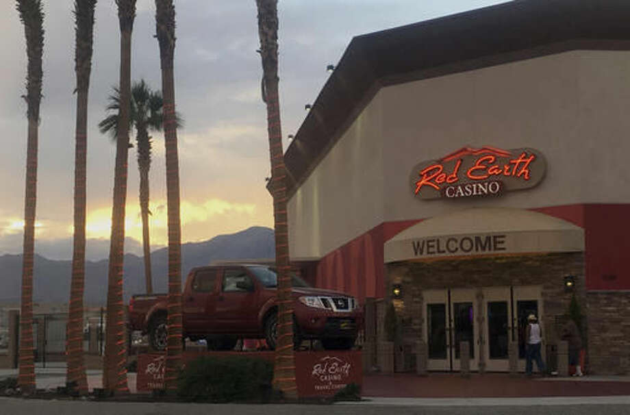 This Monday, Oct. 24, 2016, photo shows the main entrance to the Red Earth Casino in Thermal, Calif. Bus tours have been a fixture across the American landscape for years, shuttling gamblers from cities to rural places casinos are located, particularly in California where tribal operations are often hours away. Gamblers usually get $20 to $30 in tokens or casino credits. (AP Photo/Elliot Spagat)