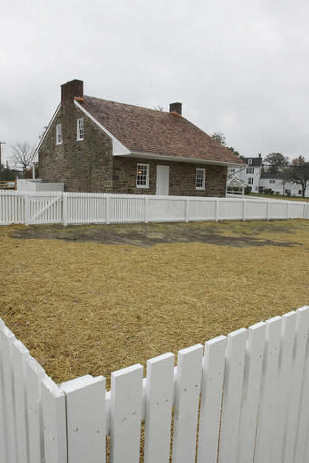 This recently restored home of Mary Thompson in Gettysburg, Pa., served as Confederate Gen. Robert E. Lee's headquarters at Gettysburg, seen Thursday, Oct. 27, 2016. A preservation group is wrapping up a $6 million project to restore the stone house and grounds. The white picket fence surrounds an area that will eventually become a garden, similar in dimension to the original garden. (AP Photo/Timothy Jacobsen)