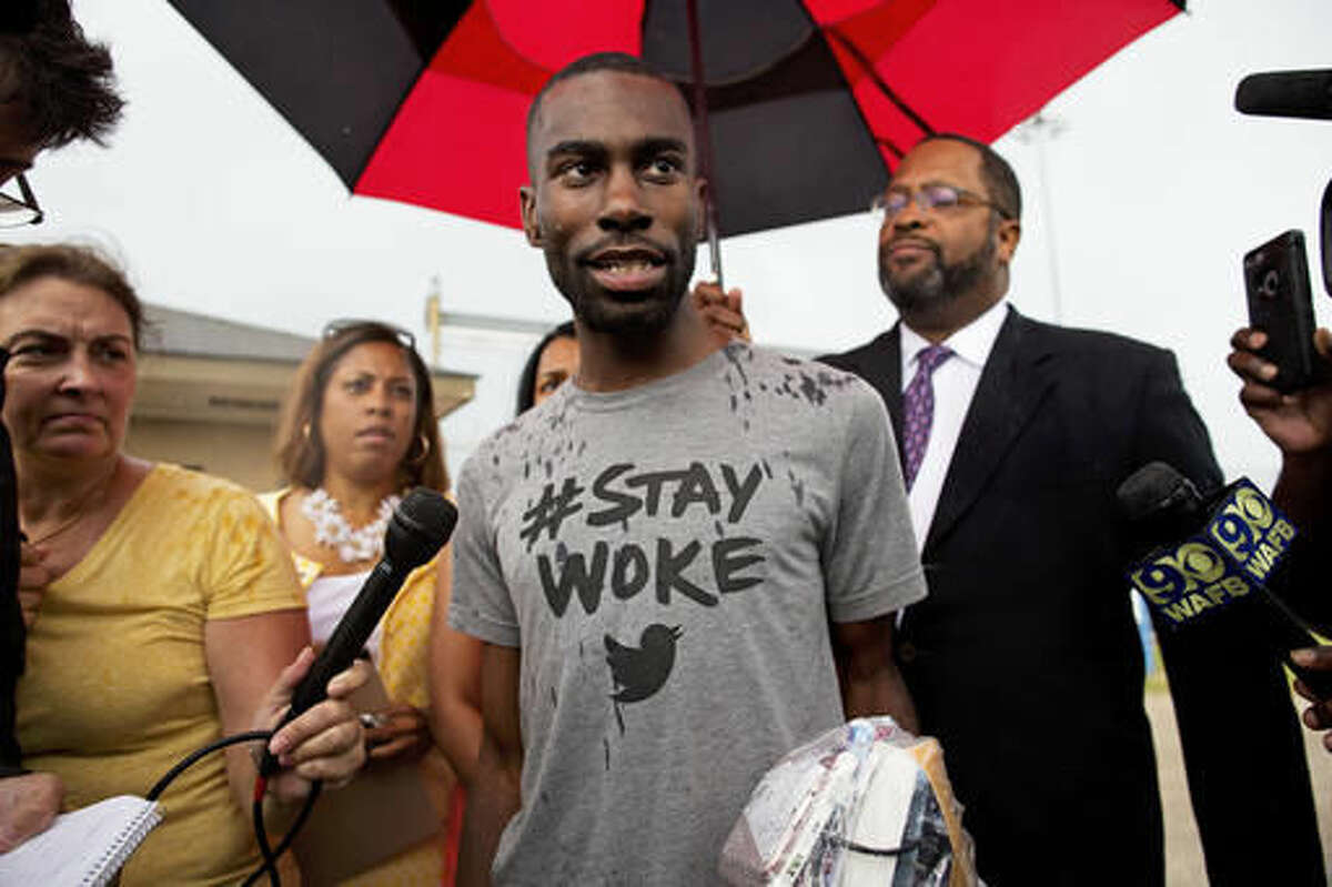 FILE- In this July 10, 2016 file photo, Black Lives Matter activist DeRay Mckesson talks to the media after his release from the Baton Rouge jail in Baton Rouge, La. Six months into Hillary Clinton's presidential campaign, she met with a group of Black Lives Matter activists in Washington to make her case and seek their support. Mckesson left disappointed, feeling Clinton lacked a grasp of the issues he had spent the previous year protesting in cities like Ferguson, Missouri, and Baltimore, including police brutality and income inequality. On Wednesday, Oct. 26, 2016, though, The Washington Post published an op-ed by Mckesson announcing his plans to vote for her after meeting again with her last week in Cleveland. (AP Photo/Max Becherer, File)