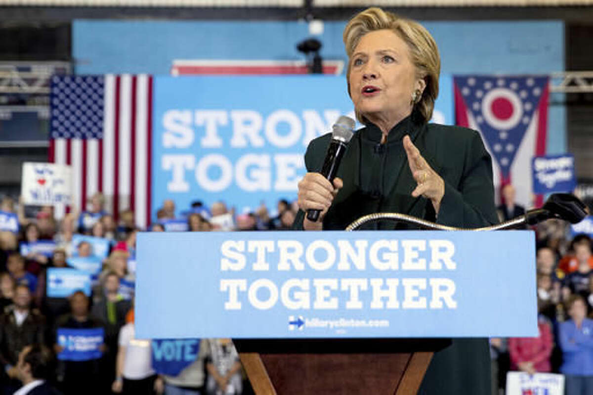 FILE - In this Friday, Oct. 21, 2016, file photo, Democratic presidential candidate Hillary Clinton speaks at a rally at Cuyahoga Community College in Cleveland. Some young black activists who had their doubts about Hillary Clinton are coming around to support her - some enthusiastically, some because they cannot stand Donald Trump. African-American voters are seen as key to Clinton's path to victory in November. (AP Photo/Andrew Harnik, File)