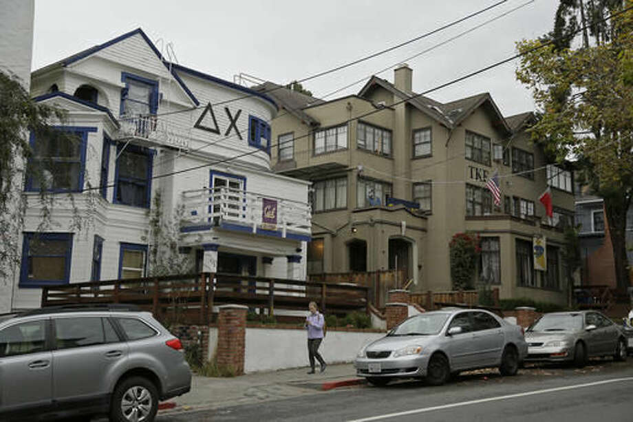 A woman walks down Channing Way past fraternities near the University of California, Berkeley campus Thursday, Oct. 27, 2016, in Berkeley, Calif. UC Berkeley's fraternity and sorority parties are back on this weekend, after a weeklong self-imposed ban. But there will be new guidelines that members say are aimed at eliminating sexual assaults.(AP Photo/Eric Risberg) Photo: AP Photo/Eric Risberg