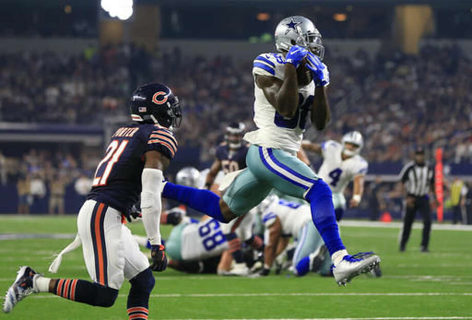 FILE - In this Sept. 25, 2016, file photo, Chicago Bears cornerback Tracy Porter (21) defends as Dallas Cowboys wide receiver Dez Bryant (88) catches a pass thrown by Dak Prescott (4) for a touchdown in the second half of an NFL football game,in Arlington, Texas. Bryant is expected to return from a knee injury this week against the Eagles. (AP Photo/Ron Jenkins, File)