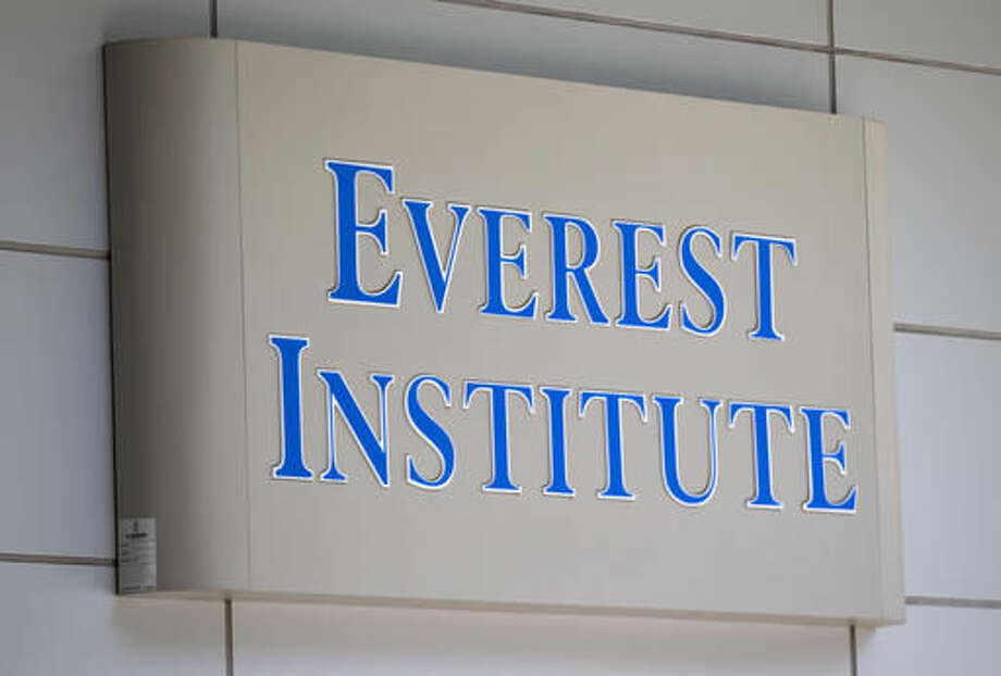FILE - In this July 8, 2014 file photo, an Everest Institute sign is seen in a office building in Silver Spring, Md. The U.S. government has issued new rules meant to help students get their federal loans erase in cases involving fraud and misconduct by their schools. Federal education officials have been working to create a clearer system for students to file claims after the U.S. Education Department received thousands from former students of the now-defunct Corinthian Colleges chain, which closed or sold all of its campuses year amid allegations of fraud.(AP Photo/Jose Luis Magana, File)