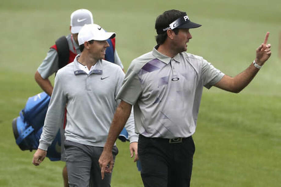 Bubba Watson from the U.S., right, and Rory McIlroy of Northern Ireland walk along the fairway during the WGC-HSBC Champions golf tournament at the Sheshan International Golf Club in Shanghai, China, Thursday, Oct. 27, 2016. (AP Photo/Ng Han Guan)
