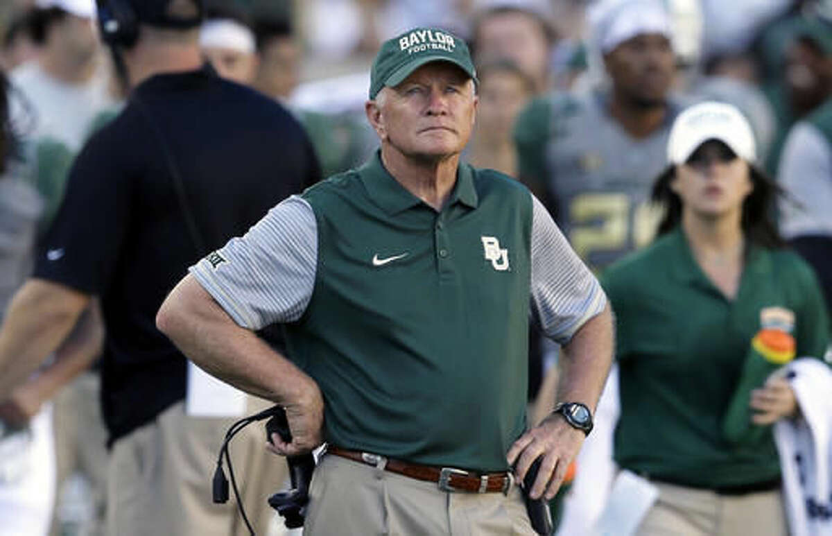 FILE - In this Sept. 10, 2016, file photo, Baylor acting head coach Jim Grobe watches from the sideline during the second half of an NCAA college football game against SMU in Waco, Texas. With Baylor and West Virginia still undefeated before the first CFP rankings, there could still be playoff hopes for the Big 12. And could there be a potential path for two-loss Oklahoma to get back in contention for a return to the playoff? (AP Photo/LM Otero, File)