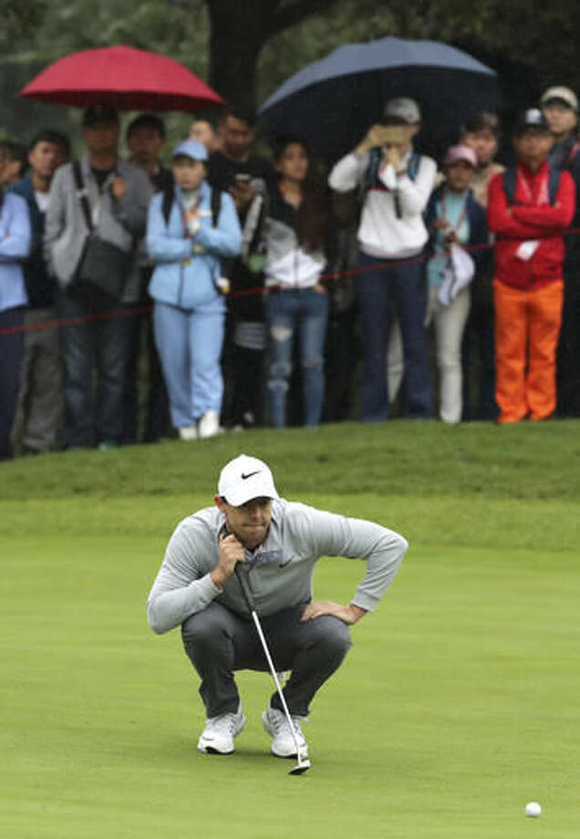 Rory McIlroy of Northern Ireland lines up his ball during the 2016 WGC-HSBC Champions golf tournament at the Sheshan International Golf Club in Shanghai, China, Thursday, Oct. 27, 2016. (AP Photo/Ng Han Guan)