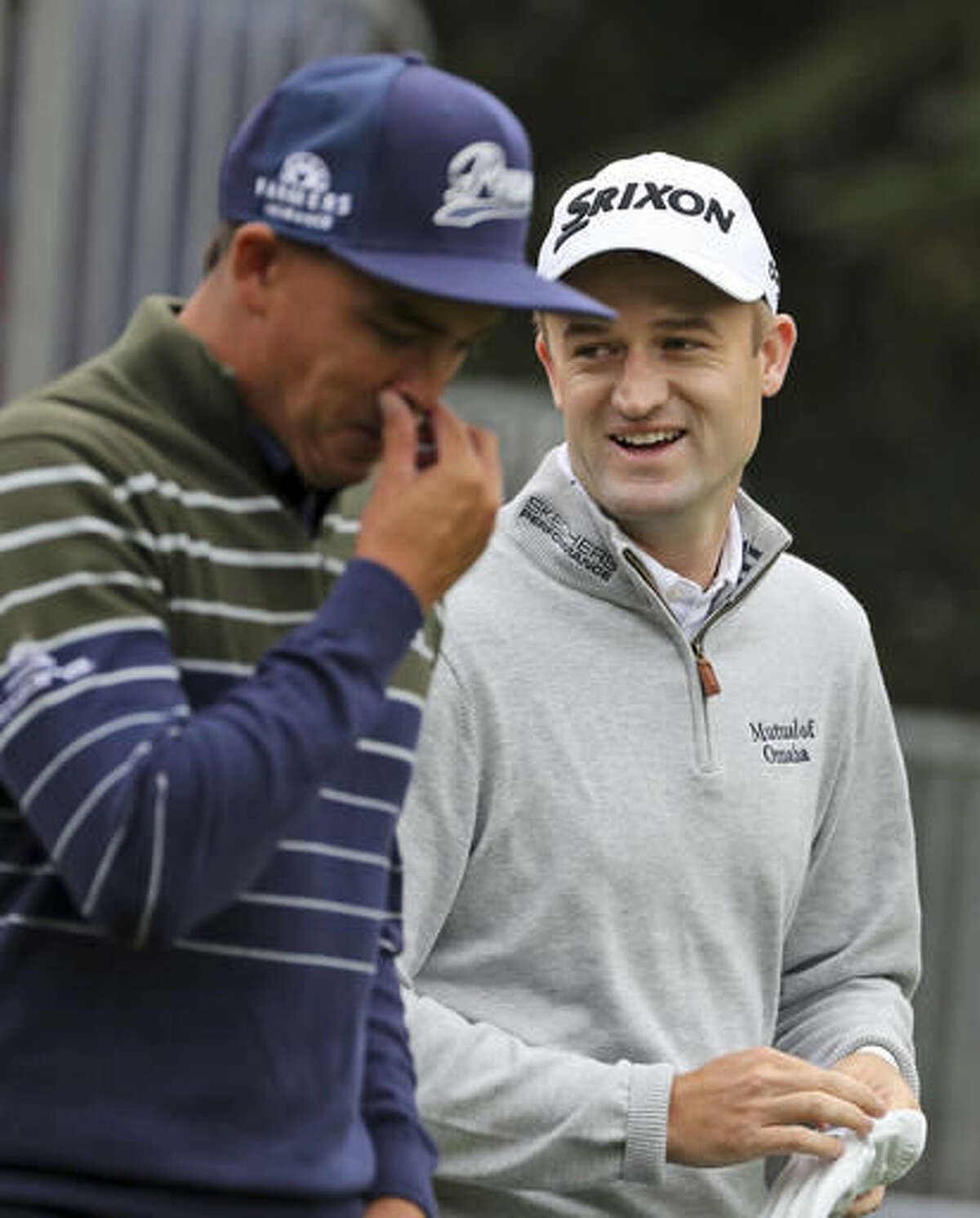 Scotland's Russell Knox, right talks to group member United State's Rickie Fowler during the 2016 WGC-HSBC Champions golf tournament at the Sheshan International Golf Club in Shanghai, China, Friday, Oct. 28, 2016. (AP Photo/Ng Han Guan)