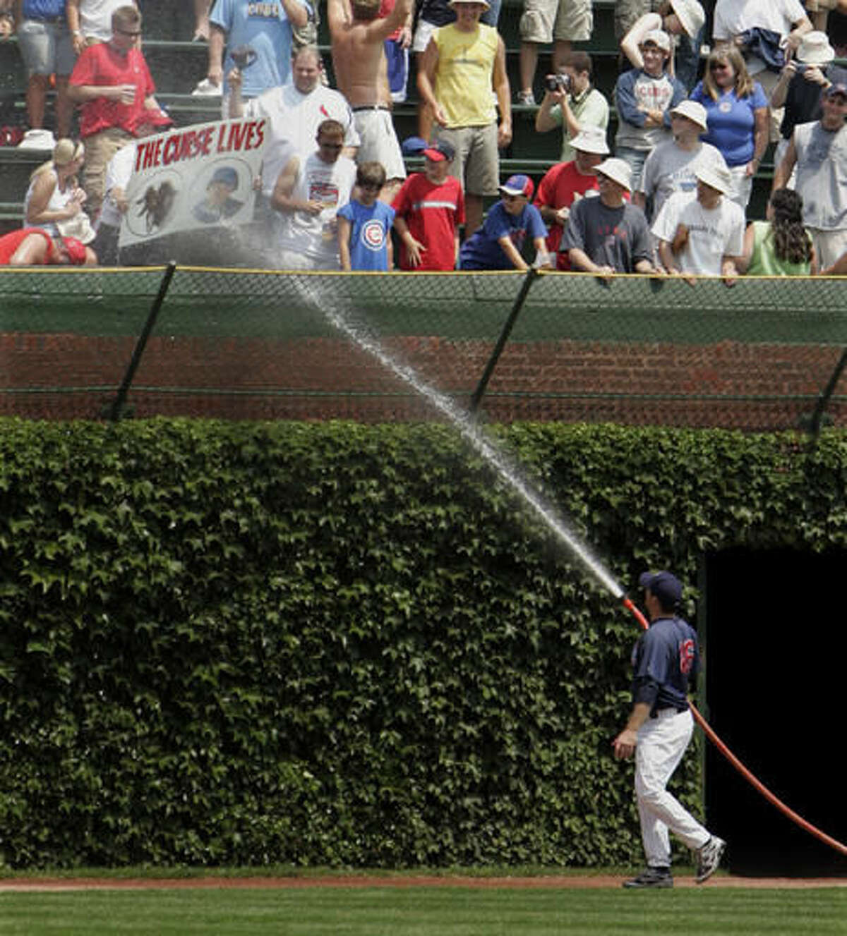 FILE - In this July 26, 2008 photo, Chicago Cubs pitcher Ryan Dempster hoses down a St. Louis Cardinals fan holding a