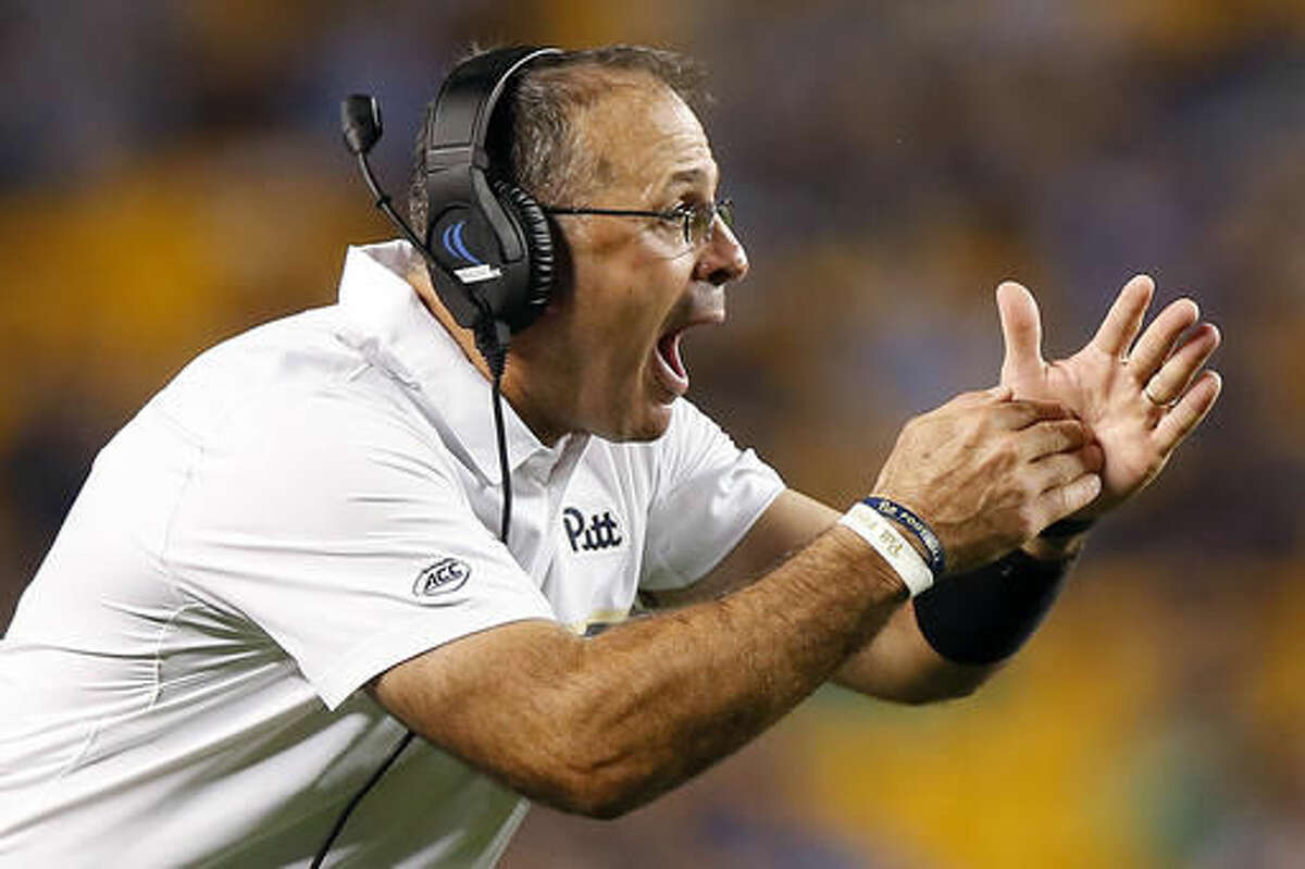 FILE - In this Oct. 1, 2016, file photo, Pittsburgh head coach Pat Narduzzi calls a timeout against Marshall during the first half of an NCAA college football game in Pittsburgh. Pitt and Virginia Tech meet on Thursday night with a chance to damage the other's ability to win the crowded ACC Coastal Division. (AP Photo/Jared Wickerham, File)