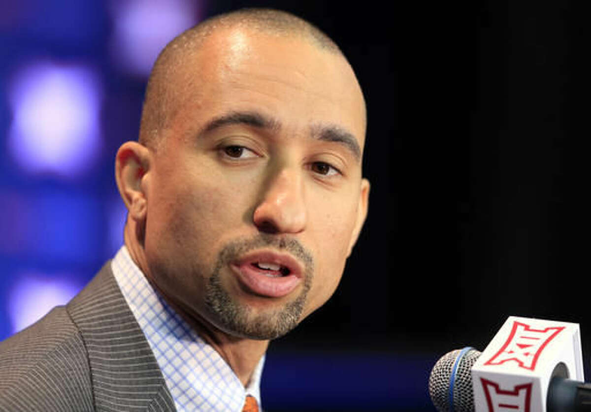 Texas coach Shaka Smart answers a reporters question at a news conference during Big 12 NCAA college basketball media day in Kansas City, Mo., Tuesday, Oct. 25, 2016. (AP Photo/Orlin Wagner)