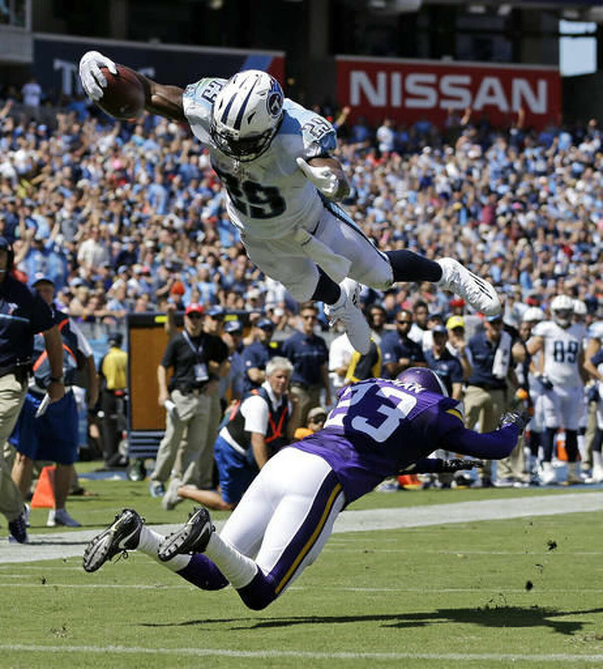 FILE - In this Sept. 11, 2016, file photo, Tennessee Titans running back DeMarco Murray (29) dives over Minnesota Vikings cornerback Terence Newman (23) as Murray scores a touchdown on a 6-yard pass reception in the first half of an NFL football game, in Nashville, Tenn. The Jaguars face the Titans in an NFL game on Thursday night in Nashville. (AP Photo/Weston Kenney, File)
