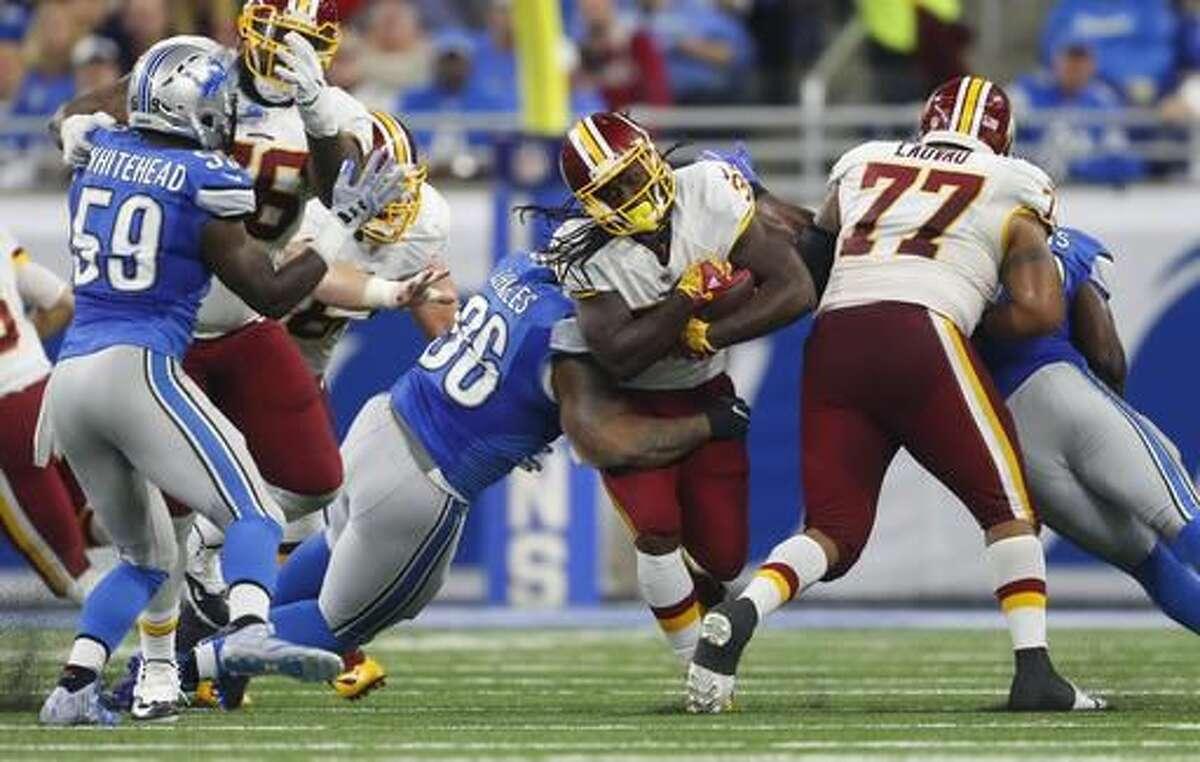 Detroit Lions defensive tackle Stefan Charles stops Washington Redskins running back Matt Jones during the first half of an NFL football game, Sunday, Oct. 23, 2016 in Detroit. (AP Photo/Paul Sancya)