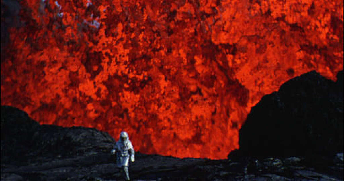 """This image released by Netflix shows a scene from the documentary, """"Into the Inferno,"""" written and directed by Werner Herzog. The film explores active volcanoes around the world. (Netflix via AP)"""