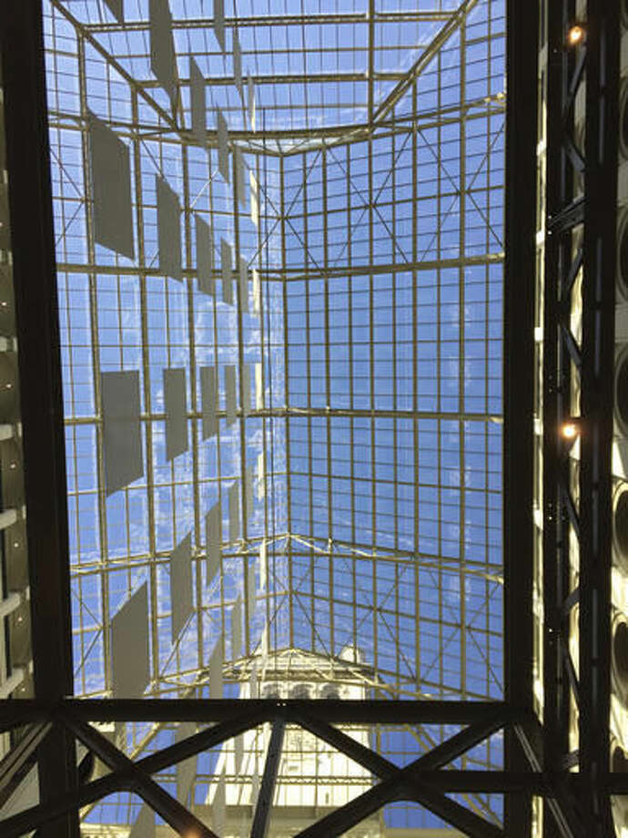 In this photo taken Oct. 25, 2016, a clock tower is seen through a skylight in the hotel lobby at the Trump International Hotel in Washington. The clock tower is operated by the National Park Service. Donald Trump Jr. on Tuesday, Oct. 25, 2016, said it would reopen to the public for free tours by the end of the year. The hotel is located in a historic building, the Old Post Office, and the roof is one of the original elements. The presidential candidate Donald Trump was scheduled to appear at the hotel Wednesday, Oct. 26, 2016, for a ribbon-cutting. (AP Photos/Beth J. Harpaz)