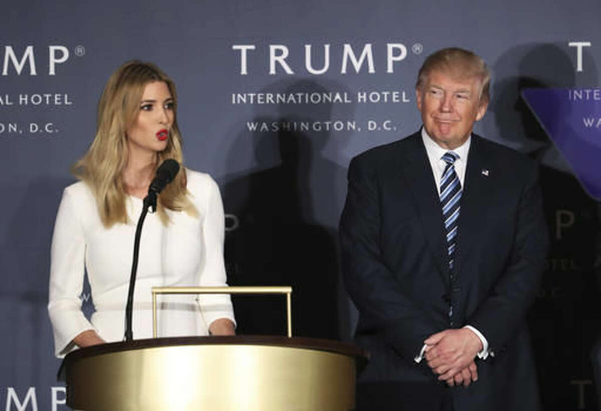 Republican presidential candidate Donald Trump listens as his daughter Ivanka Trump speaks during the grand opening of Trump International Hotel in Washington, Wednesday, Oct. 26, 2016. Donald Trump and his children hosted an official ribbon cutting ceremony and press conference to celebrate the grand opening of his new hotel. (AP Photo/Manuel Balce Ceneta)