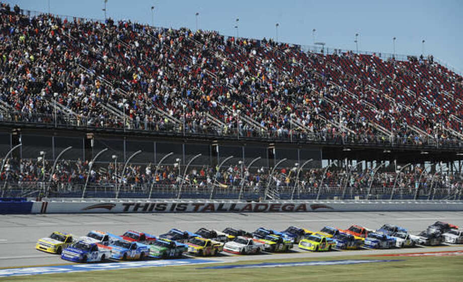 Cole Custer (00) and Grant Enfinger (24) lead the field to the start of the NASCAR Camping World Truck Series race at Talladega Superspeedway on Saturday, Oct. 22, 2016, in Talladega, Ala. (AP Photo/Rainier Ehrhardt)